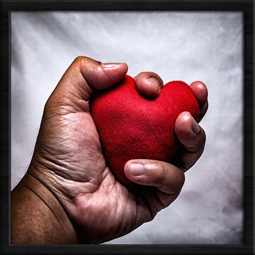 Trauma - hand with heart